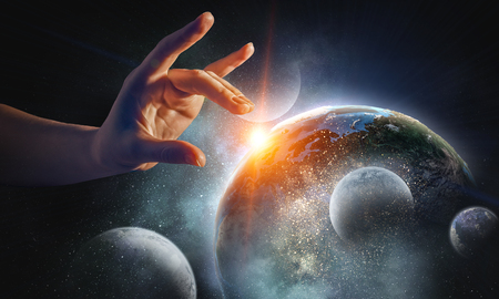 Female hand touching Earth symbolizing faith and religion. Elements of this iamge are furnished by NASA Stock fotó