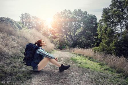 Girl hiker having rest. Mixed media