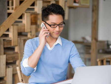 Portrait of young businessman with mobile Stock Photo