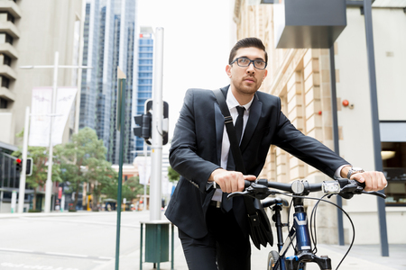 Young businessmen with a bike Stock fotó - 82043470