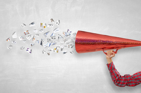 Close of woman making announcement in paper red trumpet