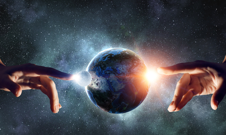 Female hand touching Earth symbolizing faith and religion. Elements of this iamge are furnished by NASA Stock fotó - 82515838