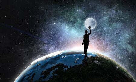 Young woman reaching moon