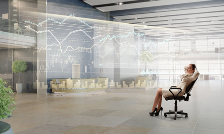 Lady boss in office chair Stock Photo
