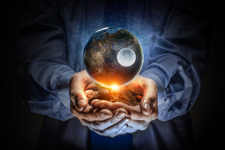 Male hands holding earth planet. Elements of this image are furnished by NASA