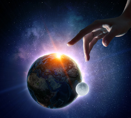 Female hand touching Earth symbolizing faith and religion. Elements of this iamge are furnished by NASA 版權商用圖片