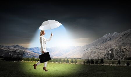 trouble free: Protecting you in any situation. Mixed media Stock Photo