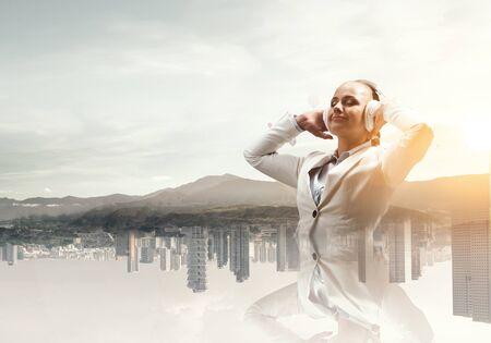 Woman wearing white headphones. Mixed media Stock Photo