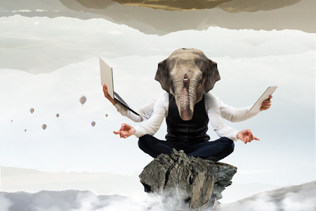 Businessman with elephant head sitting in lotus pose. Mixed media