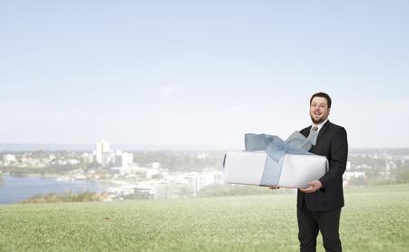 Businessman hold gift box