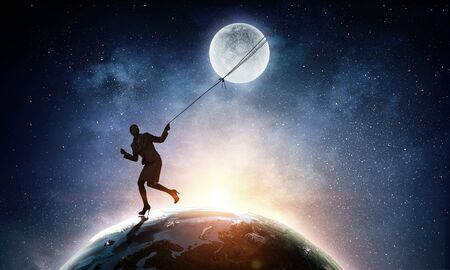 Woman catching moon