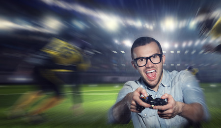 Experience the reality of game. Mixed media Stock Photo