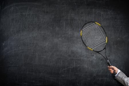 Close of hand holding tennis rocket. Mixed media Reklamní fotografie