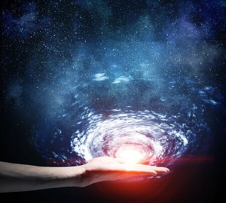 Close up of human palm in space galaxy Stock fotó