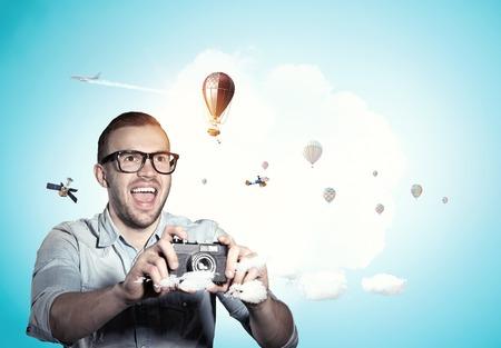 Guy with retro photocamera. Mixed media Stock Photo