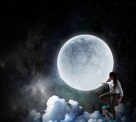 Young girl ride skateboard . Mixed media
