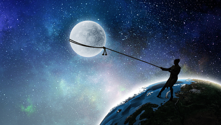 Silhouette of businesswoman catching moon on rope. Mixed media.