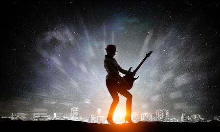 Rock girl with guitar. Mixed media