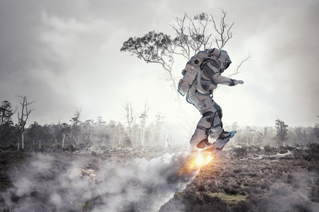 Spaceman on flying board. Mixed media Banco de Imagens