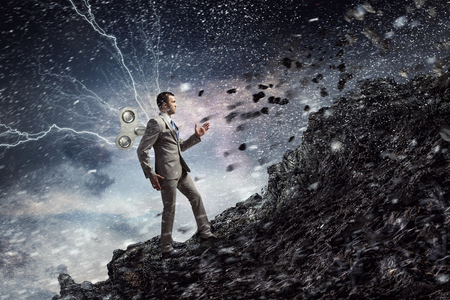 His energy and power are endless. Mixed media Stock Photo