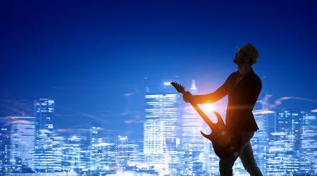 ギターでロックなヤツ。ミクスト メディア 写真素材