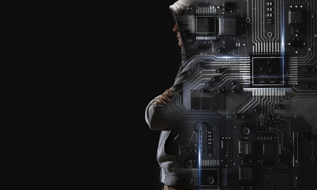 Hacker man wearing hoody against dark background. Mixed media