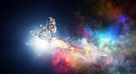 Astronaut flying on futuristic rocket skateboard in outer space. Mixed media