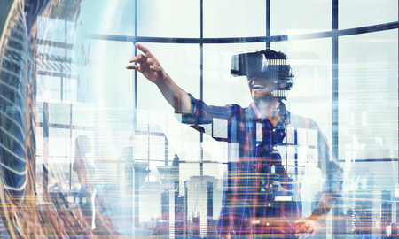 Man in virtual helmet . Mixed media Banque d'images