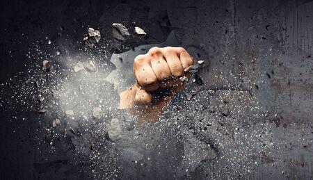 Hand breaking through the wall. Mixed media Foto de archivo