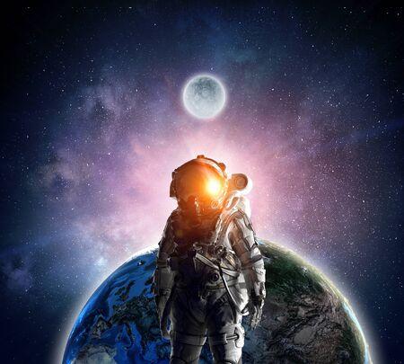 Astronaut explorer in space. Mixed media