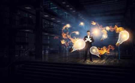 Businessman demonstrating magic . Mixed media Zdjęcie Seryjne - 83857962