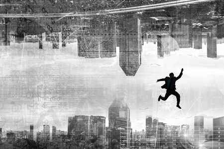 Silhouette of jumping businessman against cityscape background. Mixed media
