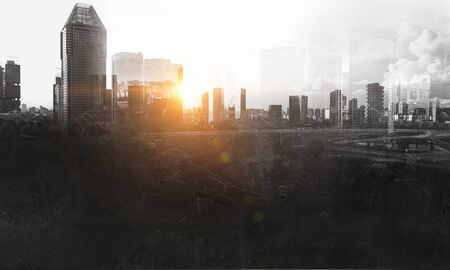 Grunge modern cityscape background with sun coming from buildings Banco de Imagens