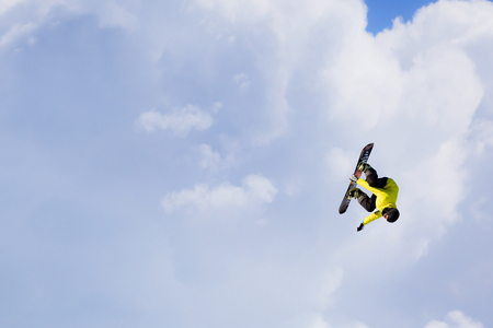 Snowboarder making jump