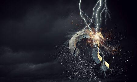 mixed media: Lightning breaking stone question mark. Mixed media
