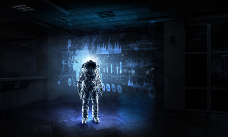 Astronaut in dark interior and media user panel. Elements of this image furnished by NASA