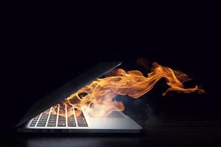 Laptop device damage. Mixed media Stock Photo