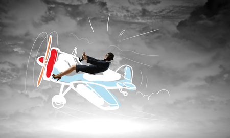 Woman in drawn airplane . Mixed media Stock Photo