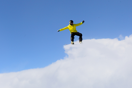Snowboarder making jump