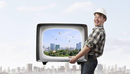 Man take tv to service. Mixed media