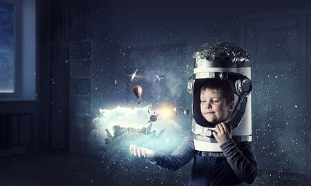 He wants to become astronaut . Mixed media Stock Photo