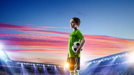 Little soccer champion. Mixed media Stock Photo