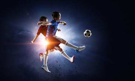 Little soccer champion. Mixed media Standard-Bild
