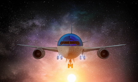 Airplane in night starry sky. Mixed media Stock Photo