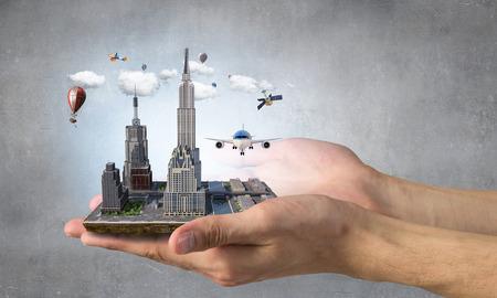Mini exterior model presented in palms. Mixed media