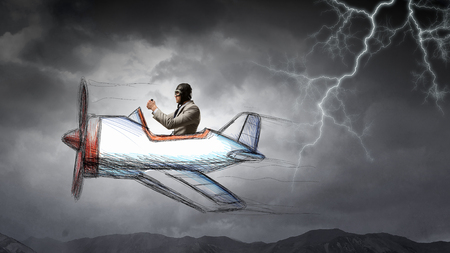 Aviator in drawn airplane. Mixed media Stock Photo