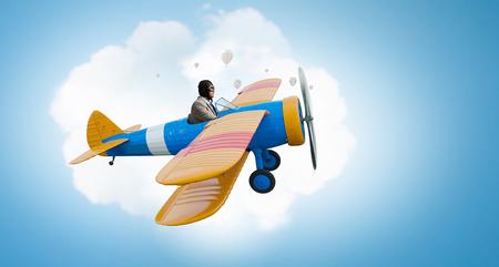Aviator in drawn airplane. Mixed media . Mixed media Фото со стока