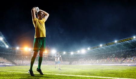 Soccer player at field. Mixed media . Mixed media