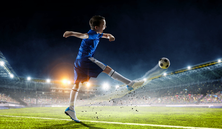 Little soccer champion. Mixed media Stock Photo