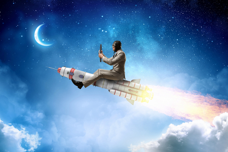 Aviator riding rocket. Mixed media